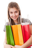 Muchacha del adolescente con los bolsos de compras Imágenes de archivo libres de regalías