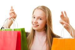 Muchacha del adolescente con los bolsos de compras Foto de archivo