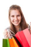 Muchacha del adolescente con los bolsos de compras Imagen de archivo libre de regalías