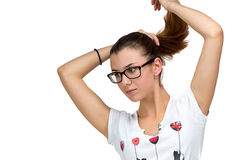 Muchacha del adolescente con los vidrios y la cola de caballo Fotos de archivo libres de regalías