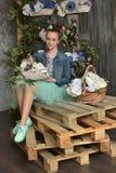 Muchacha del adolescente con una cesta de flores Imágenes de archivo libres de regalías
