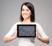 Muchacha del adolescente con una tableta Foto de archivo