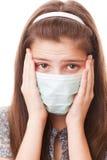 Muchacha del adolescente en máscara quirúrgica Foto de archivo