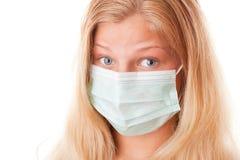 Muchacha del adolescente en máscara quirúrgica Foto de archivo libre de regalías