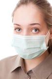 Muchacha del adolescente en máscara quirúrgica Imagen de archivo libre de regalías