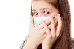 Muchacha del adolescente en máscara quirúrgica Fotografía de archivo libre de regalías
