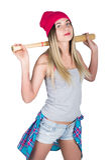 Muchacha del adolescente en pantalones cortos del dril de algodón y una camiseta gris y un sombrero de punto rosado, atados en la Imágenes de archivo libres de regalías