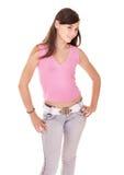 Muchacha del adolescente en pantalones vaqueros. Imagen de archivo