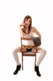 Muchacha del adolescente en silla. Foto de archivo libre de regalías
