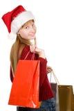 Muchacha del adolescente en sombrero de la Navidad con los bolsos de compras Imagen de archivo libre de regalías