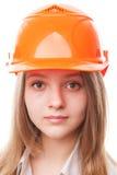 Muchacha del adolescente en un casco de protección Fotografía de archivo libre de regalías