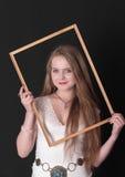 Muchacha del adolescente en un marco Fotos de archivo libres de regalías