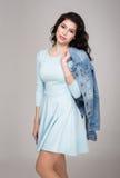 Muchacha del adolescente en un vestido azul Imagen de archivo