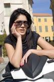 Muchacha del adolescente en una vespa Foto de archivo libre de regalías