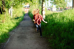 Muchacha del adolescente funcionada con lejos Fotografía de archivo libre de regalías