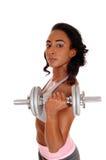 Muchacha del adolescente que ejercita con la pesa de gimnasia Imagen de archivo