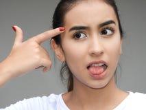 Muchacha del adolescente que hace caras divertidas Fotografía de archivo