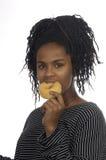Muchacha del adolescente que juega con un buñuelo Imagen de archivo