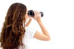 Muchacha del adolescente que mira con binocular Fotos de archivo