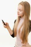 Muchacha del adolescente y teléfono móvil Imagen de archivo