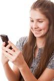 Muchacha del adolescente y teléfono móvil Imagen de archivo libre de regalías