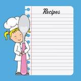 Muchacha del cocinero con una cuchara y una hoja en blanco Foto de archivo