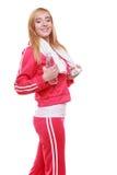 Muchacha del deporte de la mujer de la aptitud con la toalla y la botella de agua aisladas Fotografía de archivo