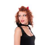 Muchacha del diablo rojo que mira detrás Imagen de archivo libre de regalías