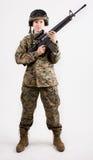 Muchacha del ejército con el arma Fotografía de archivo libre de regalías