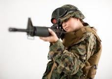 Muchacha del ejército con el arma Imagen de archivo libre de regalías