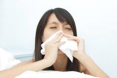 Muchacha del estornudo Fotografía de archivo libre de regalías