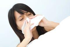 Muchacha del estornudo Fotografía de archivo