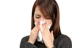 Muchacha del estornudo Foto de archivo