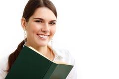 Muchacha del estudiante alegre con los libros aislados en blanco Foto de archivo