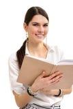 Muchacha del estudiante alegre con los libros aislados en blanco Fotografía de archivo libre de regalías