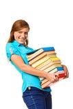 Muchacha del estudiante con el libro del color de la pila Fotos de archivo libres de regalías