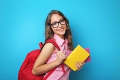 Muchacha del estudiante con la mochila Fotos de archivo