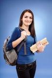 Muchacha del estudiante con la mochila y los libros Imágenes de archivo libres de regalías