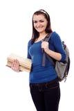 Muchacha del estudiante con la mochila y los libros Fotografía de archivo libre de regalías