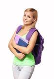 Muchacha del estudiante con la mochila y los libros aislados Fotografía de archivo libre de regalías