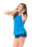 Muchacha del estudiante con los auriculares Foto de archivo libre de regalías