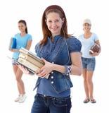 Muchacha del estudiante con los compan@eros de clase en fondo Imagen de archivo libre de regalías