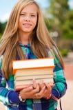 Muchacha del estudiante con los libros Imágenes de archivo libres de regalías