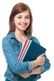 Muchacha del estudiante con los libros Foto de archivo libre de regalías