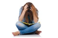 Muchacha del estudiante con los libros aislados en blanco Foto de archivo
