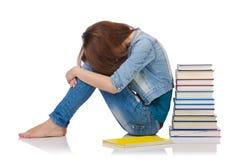 Muchacha del estudiante con los libros aislados en blanco Imagenes de archivo
