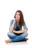 Muchacha del estudiante con los libros aislados en blanco Fotos de archivo libres de regalías