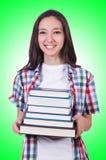 Muchacha del estudiante con muchos libros Fotos de archivo