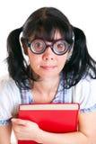 Muchacha del estudiante del empollón con los libros de textos Imagenes de archivo