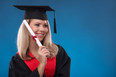 Muchacha del estudiante en fondo azul Fotografía de archivo